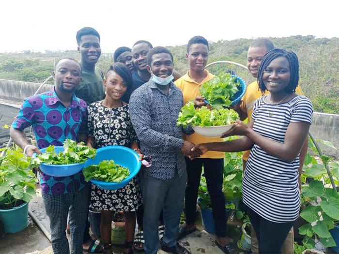 Students displaying their harvest